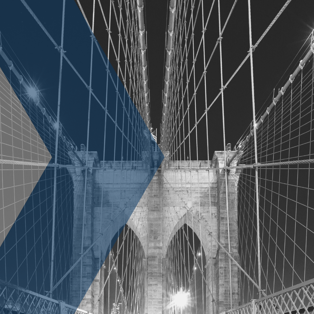Brooklyn Bridge under blue sky with overlay B&W